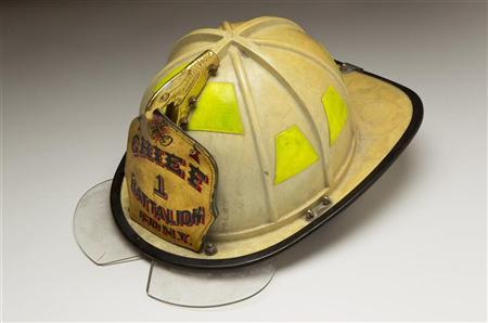 A Fire Helmet belonging to Chief Joseph Pfeifer is seen in this photograph before becoming a part of the National September 11 Memorial & Museum in New York August 22, 2011. REUTERS/Lucas Jackson