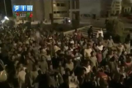 REUTERS IS UNABLE TO INDEPENDENTLY VERIFY THE CONTENTS OF THIS STILL IMAGE FROM A VIDEO OBTAINED FROM A SOCIAL MEDIA WEBSITE. Anti-government demonstrators take part in a night protest in Idleb in this still image taken from a video posted on September 3 , 2011 on a social media website. REUTERS/Social media via Reuters TV