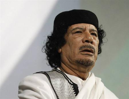 Libyan leader Muammar Gaddafi gives a speech in Rome in this August 30, 2010 file photo. Gaddafi's playful side is on display in a family video that came to light on Wednesday, but his questions to the young granddaughter tweaking his nose revealed a streak of paranoia. REUTERS/Max Rossi/Files