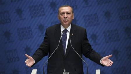 Turkish Prime Minister Recep Tayyip Erdogan addresses the media at his ruling Justice and Development Party (AKP) headquarters in Ankara June 8, 2011. REUTERS/Stringer/Files