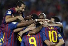 Jogadores do Barcelona comemoram gol marcado contra o Villarreal pelo Campeonato Espanhol. REUTERS/Albert Gea