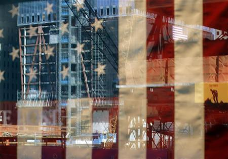 The World Trade Center construction site is reflected in a shop window in New York September 9, 2011. REUTERS/Brian Snyder