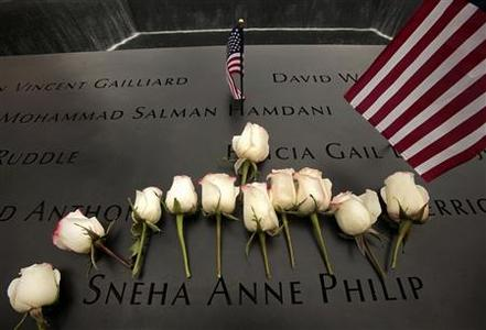 Flowers are placed at the etching of Sneha Anne Philip's name at the memorial during ceremonies marking the 10th anniversary of the 9/11 attacks on the World Trade Center, in New York, September 11, 2011. REUTERS/Carolyn Cole/Pool