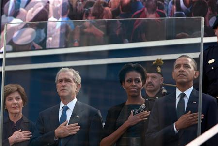 U.S. President Barack Obama, first lady Michelle Obama, former president George W. Bush (2nd L) and Laura Bush salute the flag during tenth anniversary ceremonies at the National September 11 Memorial at the World Trade Center site in New York, September 11, 2011. REUTERS/Allan Tannenbaum/Pool