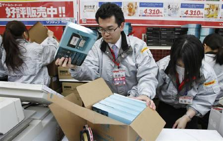 Employees at an electronic store unpack Nintendo's new 3DS game consoles as they prepare for the launch in Tokyo February 26, 2011.  REUTERS/Yuriko Nakao/Files