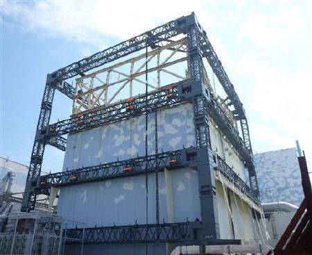 Steel frame constructed for the cover of Tokyo Electric Power Co (TEPCO)'s Fukushima Daiichi Nuclear Power Plant's Unit 1 reactor is completed in this handout photo taken by TEPCO in Fukushima prefecture, northern Japan, September 9, 2011 and released September 10, 2011. REUTERS/Tokyo Electric Power Co/Handout