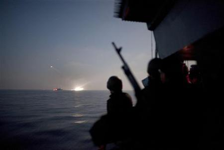 An Israeli soldier stands guard aboard a naval vessel as a Gaza-bound ship is intercepted in the Mediterranean Sea May 31, 2010. REUTERS/Uriel Sinai/Pool