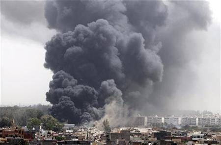 Smoke rises after coalition air strikes in Tripoli June 7, 2011. REUTERS/Stringer