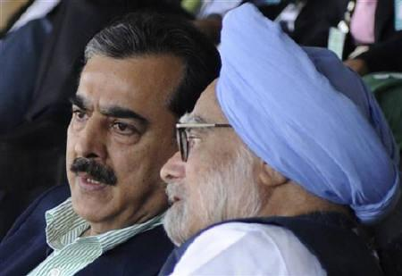 India's Prime Minister Manmohan Singh (R) speaks with his Pakistani counterpart Yusuf Raza Gilani as they watch the ICC Cricket World Cup semi-final match between India and Pakistan in Mohali March 30, 2011. REUTERS/Raveendran/Pool/Files