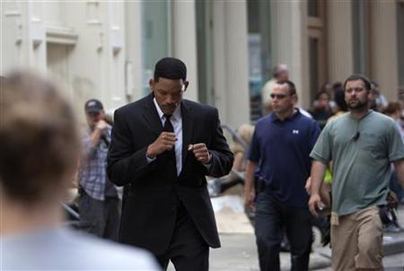 Actor Will Smith shadow boxes between takes on the set of Men In Black Three in New York City June 6, 2011. REUTERS/Andrew Kelly