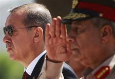 Turkey's Prime Minister Recep Tayyip Erdogan (L) stands with Egyptian army commander General Hassan al-Roweny during his visit to the late former President Anwar al-Sadat's tomb and the Unknown Soldier monument in Cairo September 13, 2011. REUTERS/Amr Abdallah Dalsh