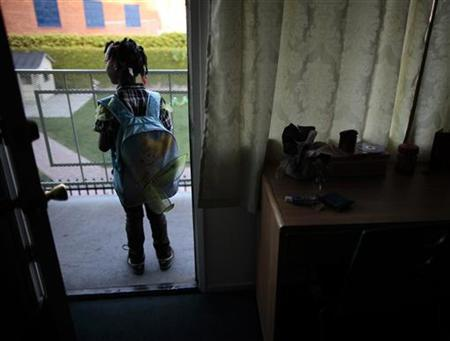 Jayla waits for her tutor to arrive at the shelter where she lives in Los Angeles, California March 16, 2011. REUTERS/Lucy Nicholson
