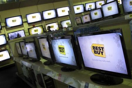 A man walks past televisions for sale at a Best Buy store in New York November 23, 2010. REUTERS/Mike Segar