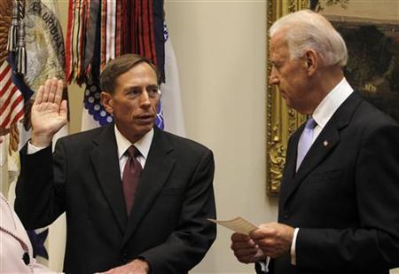 Vice President Joe Biden (R) swears-in David Petraeus as the new CIA Director, in the Roosevelt Room of the White House in Washington September 6, 2011. REUTERS/Jason Reed