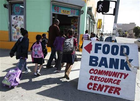 Regional coordinator Charles Evans (4th L) picks up children from school to take them to an after-school program at South Los Angeles Learning Center in Los Angeles, March 16, 2011. REUTERS/Lucy Nicholson
