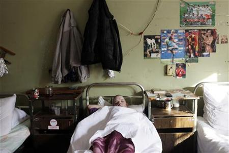 A patient sleeps in a ward set aside for heroin users and those infected with HIV in a tuberculosis hospital in the Russian town of Tver, some 170 km (106 miles) northwest of Moscow, February 21, 2011. REUTERS/Diana Markosian