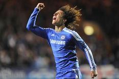 O zagueiro brasileiro do Chelsea David Luiz comemora gol contra o Bayer Leverkusen na Liga dos Campeões.  REUTERS/Toby Melville