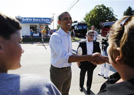 President Barack Obama greets locals after buying ice cream at DeWitt Dairy Treats in DeWitt, Iowa, August 16, 2011. REUTERS/Jason Reed