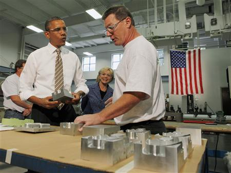 President Obama listens as he tours WestStar Precision, a small manufacturing business that Obama claims will benefit from the bipartisan proposals in the American Jobs Act, in Apex, North Carolina, September 14, 2011. REUTESR/Larry Downing