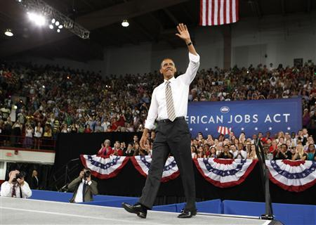 President Obama waves before he talks at North Carolina State University about the American Jobs Act that he unveiled in an address to a Joint Session of Congress last week while in Raleigh Durham, September 14, 2011. REUTERS/Larry Downing