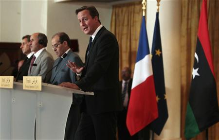 (R-L) Britain's Prime Minister David Cameron speaks, as Mahmoud Jibril, the head of the NTC executive, National Transitional Council (NTC) Chairman Mustafa Abdel Jalil and France's President Nicolas Sarkozy listen, during a news conference in Tripoli September 15, 2011. REUTERS/Anis Mili
