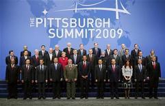 The leaders of the G20 Summit pose for a group photo at the G20 Summit in Pittsburgh, Pennsylvania, September 25, 2009.   REUTERS/Kevin Lamarque