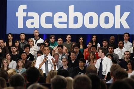 U.S. President Barack Obama attends a town hall meeting at Facebook headquarters with CEO Mark Zuckerberg in Palo Alto, April 20, 2011. REUTERS/Jim Young