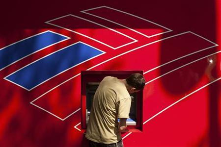 A Bank of America customer uses a Bank of America ATM in Charlotte, North Carolina May 11, 2011. REUTERS/Chris Keane