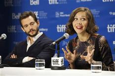"<p>Cast member Maggie Gyllenhaal speaks next to Hugh Dancy (L) during the news conference for the film ""Hysteria"" during the 36th Toronto International Film Festival (TIFF), September 15, 2011. REUTERS/Mark Blinch</p>"