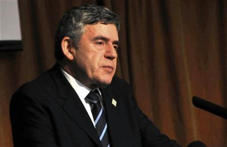 Former Prime Minister Gordon Brown speaks to African leaders at the sidelines of African Union meeting in Uganda's capital Kampala, July 24, 2010 REUTERS/Xavier Toya