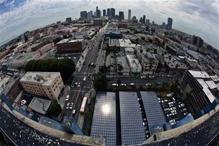 Solar panels are seen in the parking lot of 1929 building Walter J Towers, near downtown Los Angeles, California August 26, 2011.
