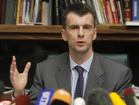 Russian billionaire Mikhail Prokhorov gestures during a news conference in Moscow September 14, 2011. REUTERS/Denis Sinyakov