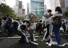 <p>People wrap each other in toilet paper as they take part in the Mp3 Experiment in New York's Bryant Park October 2, 2010. REUTERS/Jessica Rinaldi</p>