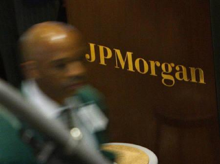 A trader walks past the JP Morgan booth on the floor of the New York Stock Exchange September 18, 2008. REUTERS/Brendan McDermid/Files