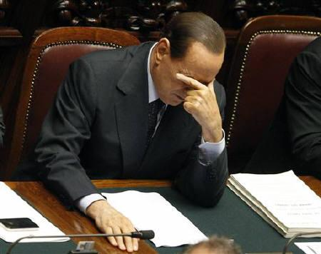 Italy's Prime Minister Silvio Berlusconi reacts during a debate in the upper house of parliament in Rome September 14, 2011. REUTERS/Max Rossi