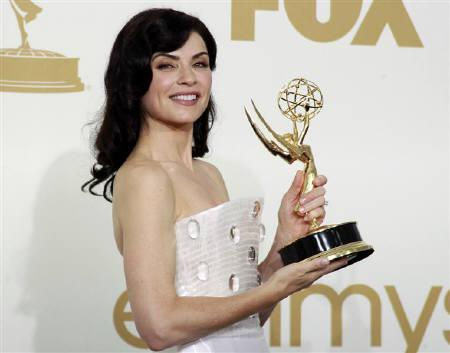 Julianna Margulies holds her Emmy award back stage after winning outstanding lead actress in a drama series for ''The Good Wife'' at the 63rd Primetime Emmy Awards in Los Angeles September 18, 2011. REUTERS/Lucy Nicholson
