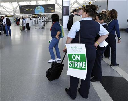Striking Air Canada employees stand inside Terminal One at Pearson International Airport in Toronto June 14, 2011. REUTERS/Mike Cassese