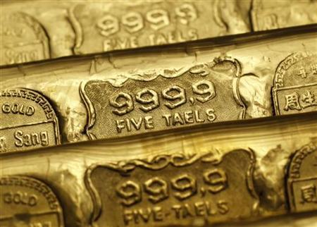 Five-tael (6.65 ounces or 190 grams) gold bars are seen at a jewellery store in Hong Kong in this August 11, 2011 illustration photo. REUTERS/Bobby Yip