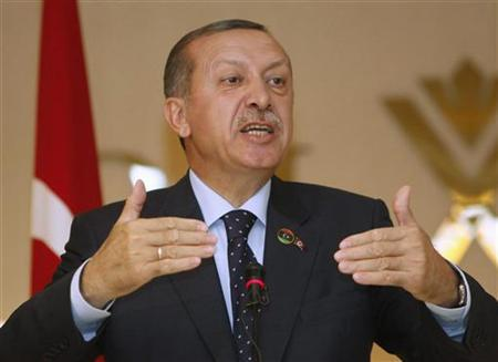 Turkey's Prime Minister Recep Tayyip Erdogan gestures during a news conference at the Rixos Hotel in Tripoli September 16, 2011. REUTERS/Ismail Zitouny