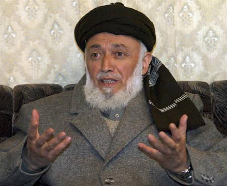 Former Afghan president Burhanuddin Rabbani speaks during an interview with Reuters in Kabul December 11, 2004. Photo taken December 11. REUTERS/Omar Sobhani/Files