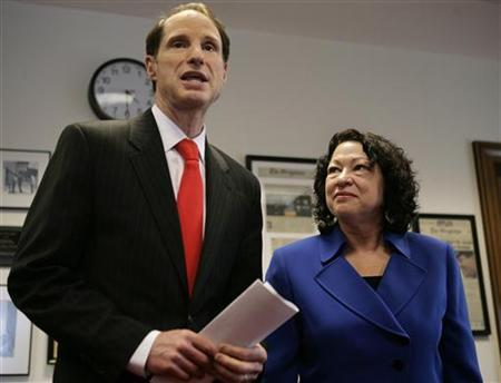 U.S. Supreme Court nominee Sonia Sotomayor (R) and Senator Ron Wyden (D-OR) talk to the media before their meeting on Capitol Hill in Washington June 3, 2009. REUTERS/Yuri Gripas