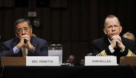 U.S. Defense Secretary Leon Panetta (L) and Chairman of the Joint Chiefs of Staff Admiral Mike Mullen attend a Senate Armed Services Committee hearing on Capitol Hill in Washington September 22, 2011.    REUTERS/Jason Reed