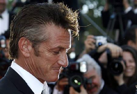Sean Penn arrives on the red carpet for the screening of the film ''This Must Be The Place'', by director Paolo Sorrentinio, in competition at the 64th Cannes Film Festival May 20, 2011. REUTERS/Jean-Paul Pelissier/Files