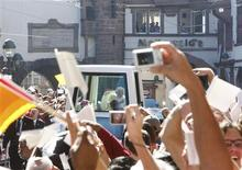The popemobile with Pope Benedict XVI drives along the main shopping street of Freiburg, September 24, 2011.  REUTERS/Michael Probst/Pool