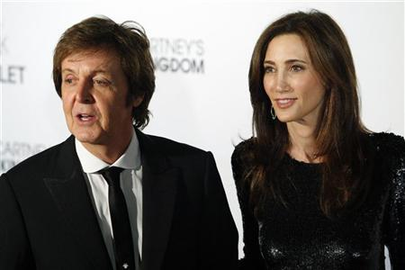Former Beatle Paul McCartney and his fiancee, New York heiress Nancy Shevell, arrive for the world premiere of his ballet ''Ocean's Kingdom'' in New York September 22, 2011. REUTERS/Kena Betancur