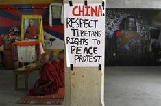 Tibetan monks living in Nepal pray during a 24-hour hunger strike at the Tibetan Youth Club in Kathmandu April 18, 2011, to express solidarity with compatriots who were victims of a Chinese crackdown in Ngaba, Sichuan Province last month. REUTERS/Navesh Chitrakar