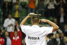 Российский теннисист Михаил Южный на игре в Казани, 18 сентября 2011 года. Российские теннисисты по-прежнему остаются за пределами первой 30-ки рейтинга сильнейших теннисистов планеты по версии ATP, свидетельствует его обновленная версия. REUTERS/Grigory Dukor