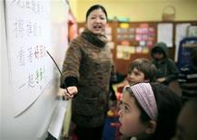 <p>Teacher Kennis Wong (L) points to Chinese characters on the board at Broadway Elementary School in Venice, Los Angeles, California, April 11, 2011. The school launched one of only two English-Mandarin Chinese dual-language immersion programs in the Los Angeles Unified School District in September 2010. REUTERS/Lucy Nicholson</p>