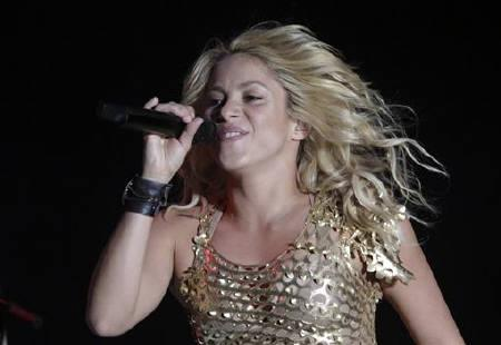 Colombian pop star Shakira performs during her concert as part of ''The Sun Comes Out World Tour'' in Puebla July 24, 2011. REUTERS/Imelda Medina/Files