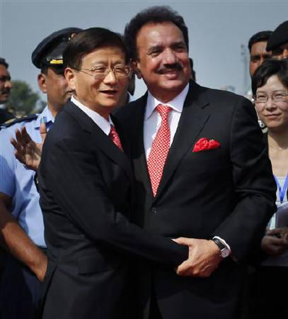 Pakistani Interior Minister Rehman Malik (R) greets Chinese Public Security Minister Meng Jianzhu after his arrival at a military base in Rawalpindi, September 26, 2011. REUTERS/Mian Khursheed